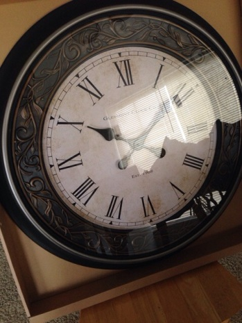 This clock is GIANT. It'll go in the living room.