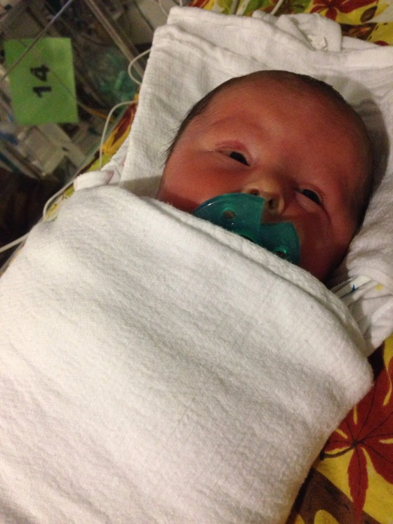 Baby burrito with the pacifier is about the only way to soothe a 'hungry' baby.